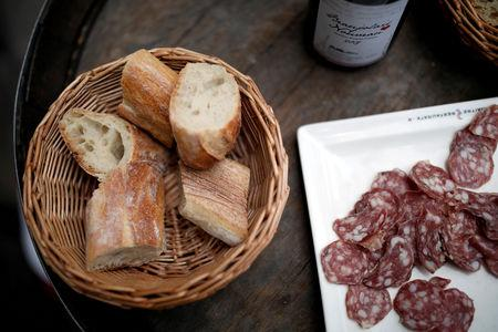 FILE PHOTO: Pieces of French baguette and sausage are seen in a bistrot in Paris, France, November 16, 2017. REUTERS/Benoit Tessier