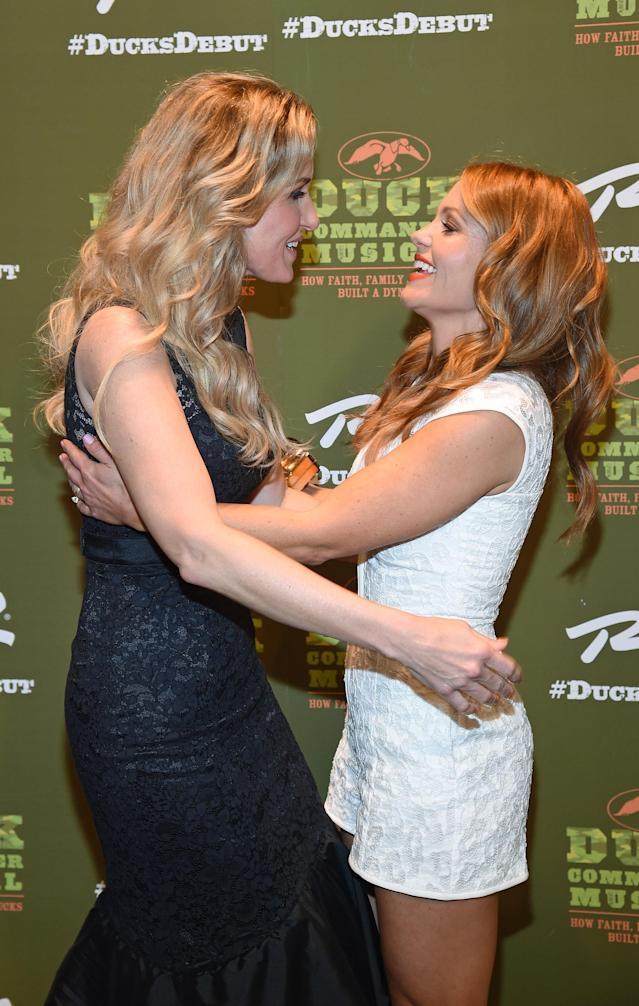 Korie Robertson and Candace Cameron Bure say hi on the red carpet at the <em>Duck Commander Musical</em> premiere at the Crown Theater at the Rio Hotel & Casino on April 15, 2015 in Las Vegas. (Photo: Ethan Miller/Getty Images)