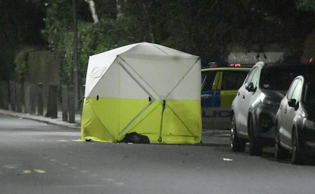 A police tent on the street outside yesterday. A man believed to be in his 30s suffered gunshot injuries and was pronounced dead at the scene. (Getty)