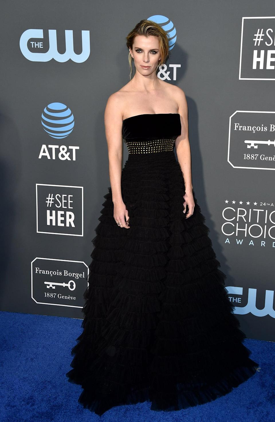 <p>Betty Gilpin wearing a J.Mendel dress and APM Monaco jewels.</p>