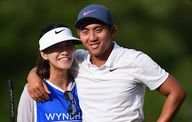 "<h1 class=""title"">Wyndham Championship - Final Round</h1> <div class=""caption""> GREENSBORO, NC - AUGUST 19: C.T. Pan of Taiwan stands on the 18th green with his wife and caddie Michelle Lin during the final round of the Wyndham Championship at Sedgefield Country Club on August 19, 2018 in Greensboro, North Carolina. (Photo by Jared C. Tilton/Getty Images) </div> <cite class=""credit"">Jared C. Tilton</cite>"
