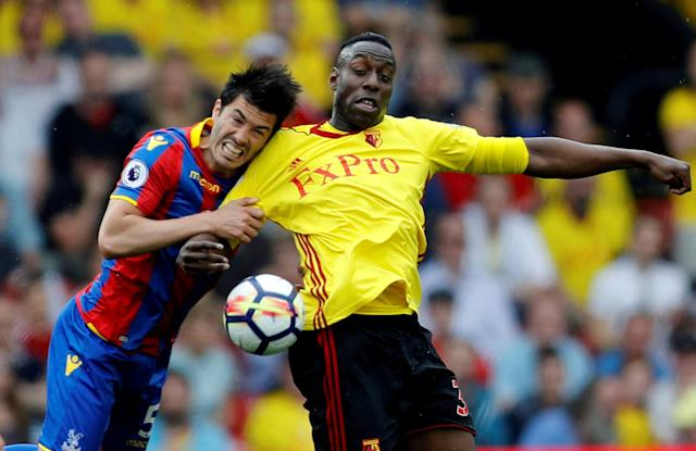 "Soccer Football - Premier League - Watford v Crystal Palace - Vicarage Road, Watford, Britain - April 21, 2018 Watford's Stefano Okaka in action with Crystal Palace's James Tomkins REUTERS/Darren Staples EDITORIAL USE ONLY. No use with unauthorized audio, video, data, fixture lists, club/league logos or ""live"" services. Online in-match use limited to 75 images, no video emulation. No use in betting, games or single club/league/player publications. Please contact your account representative for further details. TPX IMAGES OF THE DAY"
