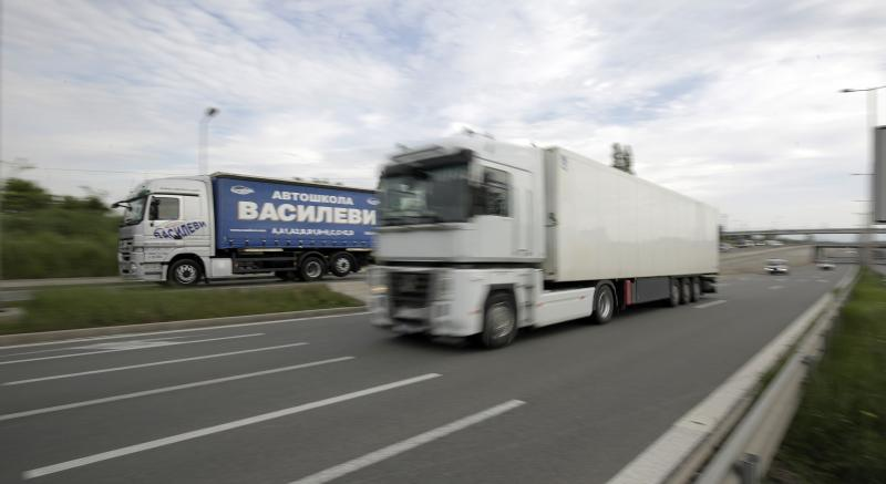Trucks travel along Sofia's ring-road on Monday, May 13, 2019. The future of Bulgaria's vast number of low-wage truck drivers has become a top campaign issue in the country heading into European Parliament elections, with debates raging on how new EU rules could threaten the workers and deepen divisions between rich and poor nations in the bloc. (AP Photo/Valentina Petrova)