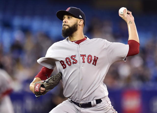 FILE - In this May 12, 2018, file photo, Boston Red Sox starting pitcher David Price works against the Toronto Blue Jays during the first inning of a baseball game in Toronto on Saturday, May 12, 2018. Price ,coming off a complete-game victory over Baltimore, pitches against his original team and buddy Chris Archer when Boston visits Tampa Bay on Wednesday. (Frank Gunn/The Canadian Press via AP, File)