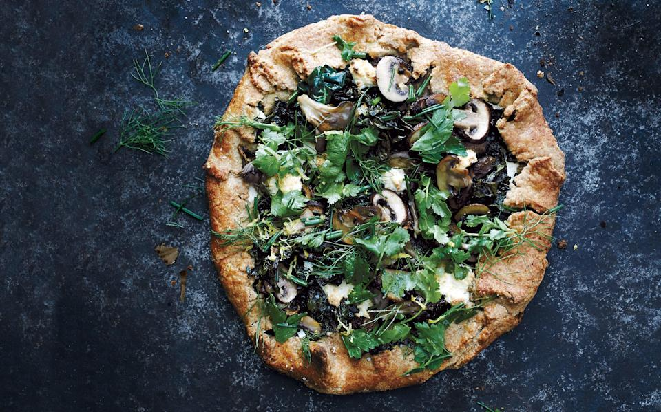 "Selling skeptics on the idea of a vegetarian dinner is easy when it's in pie form. Maitake mushrooms add heft. <a href=""https://www.bonappetit.com/recipe/swiss-chard-and-mushroom-galette?mbid=synd_yahoo_rss"" rel=""nofollow noopener"" target=""_blank"" data-ylk=""slk:See recipe."" class=""link rapid-noclick-resp"">See recipe.</a>"