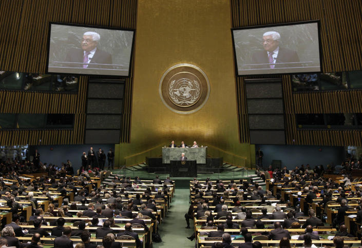 """Palestinian President Mahmoud Abbas acknowledges applause before he addresses the United Nations General Assembly, Thursday, Nov. 29, 2012. In a statement Thursday, Abbas appealed to all nations to vote in favor of the Palestinians """"as an investment in peace. (AP Photo/Richard Drew)"""