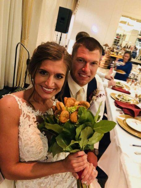 PHOTO: Blair and Adam Tyson got the surprise of a lifetime when they toasted with a chicken nugget bouquet supplied by the Tyson brand at their wedding reception on Oct. 12. (Jenna Spetz)