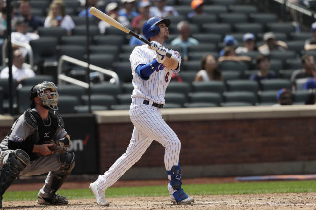 New York Mets' Jeff McNeil hits a two-run home run in the seventh inning of a baseball game against the Miami Marlins, Wednesday, Aug. 7, 2019 in New York. Marlins catcher Bryan Holiday watches the hit. (AP Photo/Mark Lennihan)