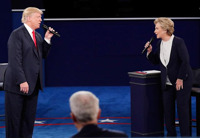 <p>Republican presidential nominee Donald Trump and Democratic U.S. presidential nominee Hillary Clinton speak during their presidential town hall debate at Washington University in St. Louis, Mo., Oct. 9, 2016. (Photo: Jim Young/Reuters) </p>