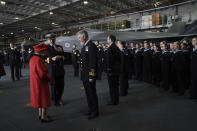 Britain's Queen Elizabeth II, left, meets personnel, during a visit to HMS Queen Elizabeth at HM Naval Base, ahead of the ship's maiden deployment, in Portsmouth, England, Saturday May 22, 2021. HMS Queen Elizabeth will be leading a 28-week deployment to the Far East that Prime Minister Boris Johnson has insisted is not confrontational towards China. (Steve Parsons/Pool Photo via AP)