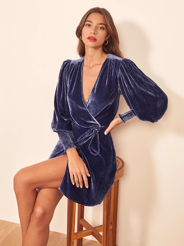 """<p>This <a href=""""https://www.popsugar.com/buy/Reformation-Boheme-Dress-517822?p_name=Reformation%20Boheme%20Dress&retailer=thereformation.com&pid=517822&price=278&evar1=fab%3Aus&evar9=46901824&evar98=https%3A%2F%2Fwww.popsugar.com%2Fphoto-gallery%2F46901824%2Fimage%2F46901847%2FReformation-Boheme-Dress&list1=shopping%2Cdresses%2Cparty%20dresses%2Cwinter%2Cnew%20years%20eve%2Cnew%20year%2Cwinter%20fashion&prop13=api&pdata=1"""" rel=""""nofollow"""" data-shoppable-link=""""1"""" target=""""_blank"""" class=""""ga-track"""" data-ga-category=""""Related"""" data-ga-label=""""https://www.thereformation.com/products/boheme-dress?color=Danube&amp;via=Z2lkOi8vcmVmb3JtYXRpb24td2VibGluYy9Xb3JrYXJlYTo6Q2F0YWxvZzo6Q2F0ZWdvcnkvNWRiZjcwZTFmMzViZTI0NTNlMjM3NzU5"""" data-ga-action=""""In-Line Links"""">Reformation Boheme Dress</a> ($278) is appropriate for so many occasions.</p>"""