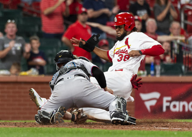 St. Louis Cardinals' Jose Martinez, right, scores against Miami Marlins catcher Bryan Holaday during the 11th inning of a baseball game Thursday, June 20, 2019, in St. Louis. Miami won 7-6. (AP Photo/L.G. Patterson)