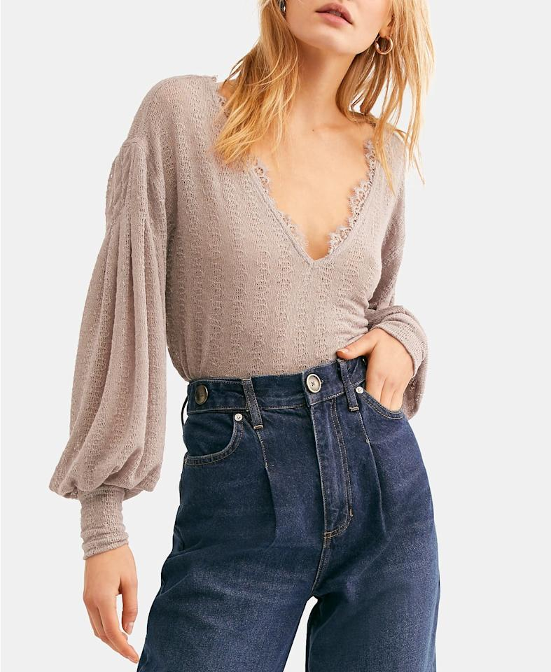 """<p>You'll want to live in this <a href=""""https://www.popsugar.com/buy/Free-People-Dream-Girl-V-Neck-Bishop-Sleeve-Top-491734?p_name=Free%20People%20Dream%20Girl%20V-Neck%20Bishop-Sleeve%20Top&retailer=macys.com&pid=491734&price=41&evar1=fab%3Aus&evar9=46631817&evar98=https%3A%2F%2Fwww.popsugar.com%2Fphoto-gallery%2F46631817%2Fimage%2F46631979%2FFree-People-Dream-Girl-V-Neck-Bishop-Sleeve-Top&list1=shopping%2Cfall%20fashion%2Cfall%2Ctops%2Cmacys&prop13=api&pdata=1"""" rel=""""nofollow"""" data-shoppable-link=""""1"""" target=""""_blank"""" class=""""ga-track"""" data-ga-category=""""Related"""" data-ga-label=""""https://www.macys.com/shop/product/free-people-dream-girl-v-neck-bishop-sleeve-top?ID=8413993&amp;CategoryID=255#fn=SPECIAL_OCCASIONS%3DCasual%3B%3BFormal%3B%3BGoing%20Out%3B%3BWear%20to%20Work%26sp%3D1%26spc%3D11469%26ruleId%3D105%7CBOOST%20ATTRIBUTE%7CBOOST%20SAVED%20SET%26searchPass%3DmatchNone%26slotId%3D50"""" data-ga-action=""""In-Line Links"""">Free People Dream Girl V-Neck Bishop-Sleeve Top</a> ($41, originally $68).</p>"""
