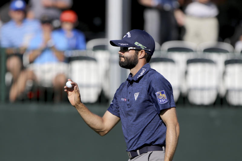 Adam Hadwin acknowledges the crowd moments after making a birdie at 17 while playing in the second round of the Valspar Golf Championship at Innisbrook Resort and Golf Club's Copperhead Course on Friday, March 10, 2017, in Palm Harbor, Fla. (Douglas R. Clifford/The Tampa Bay Times via AP)