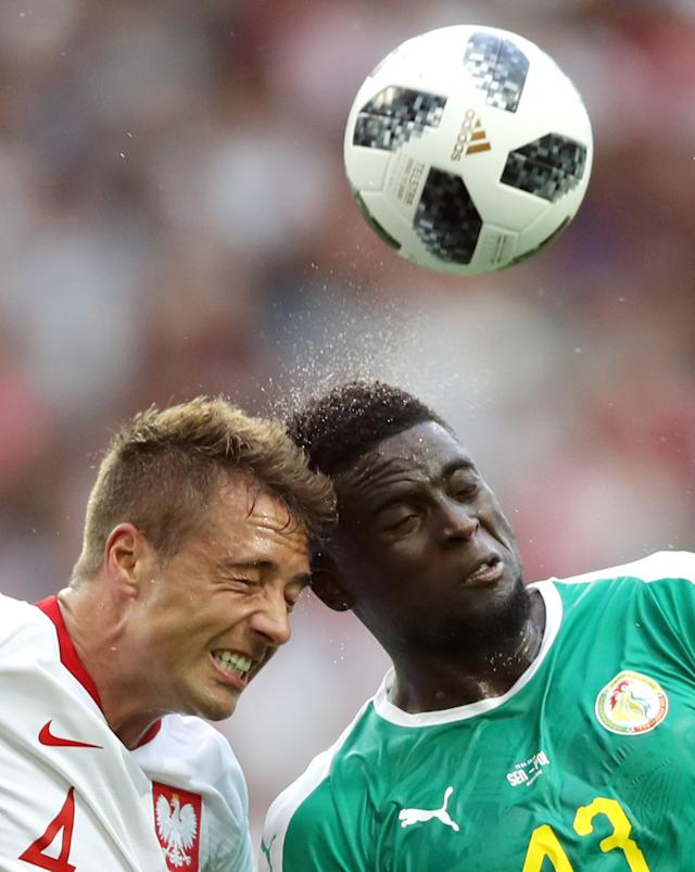 Soccer Football - World Cup - Group H - Poland vs Senegal - Spartak Stadium, Moscow, Russia - June 19, 2018 Poland's Thiago Cionek in action with Senegal's Alfred N'Diaye REUTERS/Carl Recine