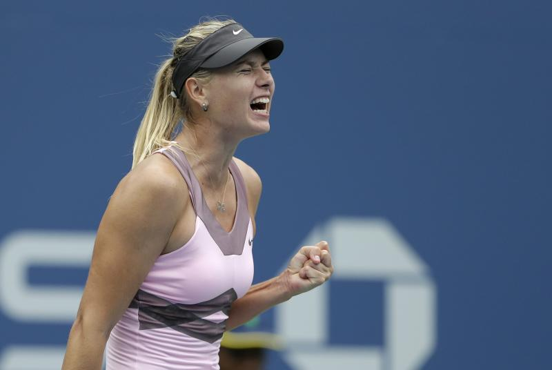 Russia's Maria Sharapova celebrates during her match with Marion Bartoli, of France, in the quarterfinals during the 2012 US Open tennis tournament,  Wednesday, Sept. 5, 2012, in New York. (AP Photo/Darron Cummings)