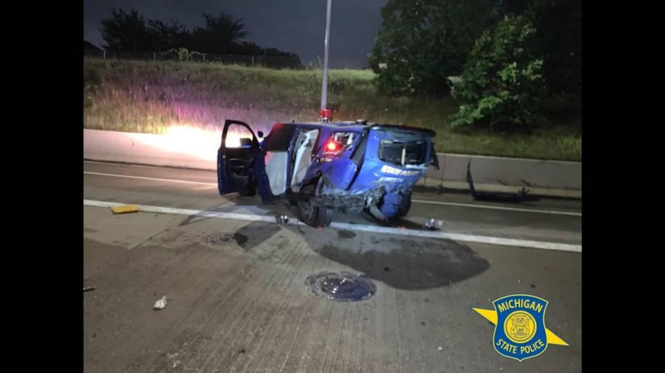 """The Michigan State Police trooper involved in the crash told investigators the sedan that hit him was traveling at """"freeway speed."""""""