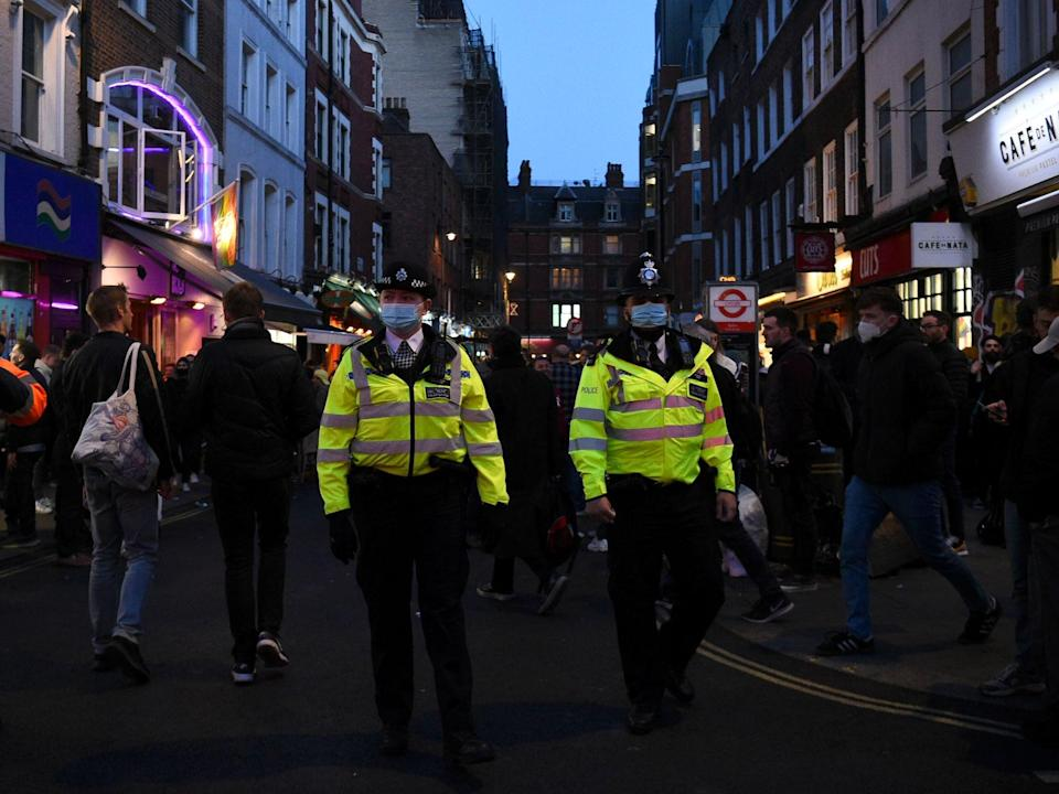 Police Officers in central London, on the first Friday evening after pubs in England were allowed to reopen to serve customers outside (PA)