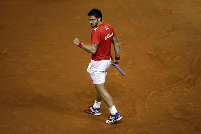 Serbia's Janko Tipsarevic clinches his fist as he celebrates a point won against Canada's Vasek Pospisil during their Davis Cup semifinals tennis match in Belgrade, Serbia, Sunday, Sept. 15, 2013. (AP Photo/ Marko Drobnjakovic)