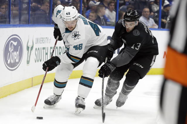 San Jose Sharks center Tomas Hertl (48) gets around Tampa Bay Lightning center Cedric Paquette (13) during the first period of an NHL hockey game Saturday, Dec. 7, 2019, in Tampa, Fla. (AP Photo/Chris O'Meara)