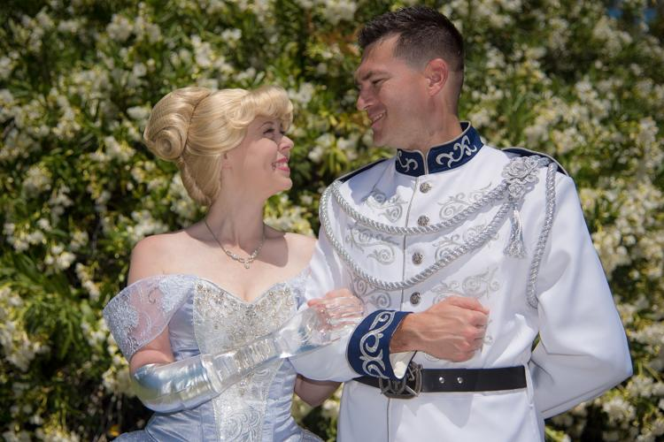 Mandy Pursley, in her hand-sewn Cinderella costume and glass arm, with her husband, Ryan Pursley, as Prince Charming. (Photo: Kelly Anderson)