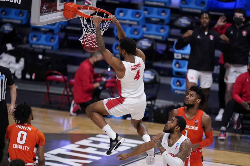 Houston forward Justin Gorham (4) dunks against Syracuse in the second half of a Sweet 16 game in the NCAA men's college basketball tournament at Hinkle Fieldhouse in Indianapolis, Saturday, March 27, 2021. (AP Photo/Michael Conroy)