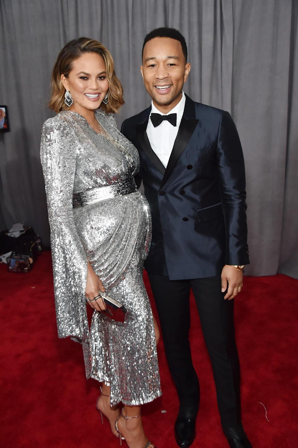 """<h1 class=""""title"""">Chrissy Teigen in Yanina Couture and Lorraine Schwartz jewelry and John Legend in Burberry, Chopard jewelry andBruno Magli shoes</h1><cite class=""""credit"""">Photo: Getty Images</cite>"""
