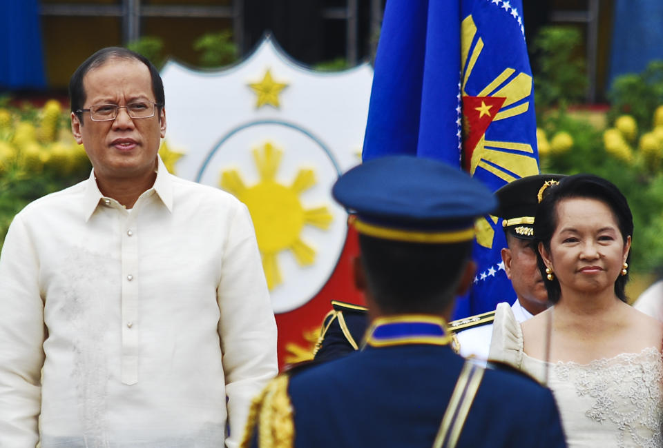 FILE PHOTO: President-elect Noynoy Aquino and outgoing President Gloria Macapagal-Arroyo review Honor Guards during the inauguration of Noynoy Aquino as the fifteenth President of the Philippines at Quirino Grandstand on June 30, 2010 in Manila, Philippines. (Photo: Dondi Tawatao/Getty Images)