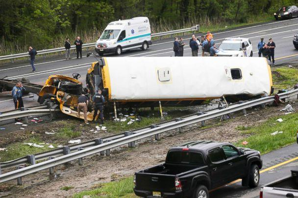 PHOTO: Emergency personnel work at the scene of a school bus and dump truck collision, injuring multiple people, on Interstate 80 in Mount Olive, N.J., on May 17, 2018. (Seth Wenig/AP)