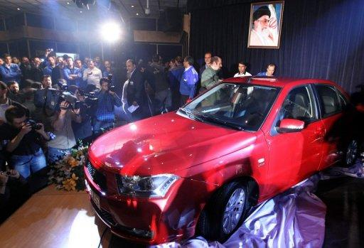 """Iran's leading automaker Iran Khodro unveils a new local saloon dubbed """"Dena"""" in Tehran last year. Iran's automobile market is highly protected against imports, allowing in only 40,000 vehicles last year, despite steadily growing demand mostly met through domestic production of some 1.6 mn cars per year"""