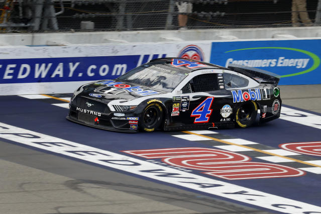 Kevin Harvick crosses the finish line to win a NASCAR Cup Series auto race at Michigan International Speedway in Brooklyn, Mich., Sunday, Aug. 11, 2019. (AP Photo/Paul Sancya)