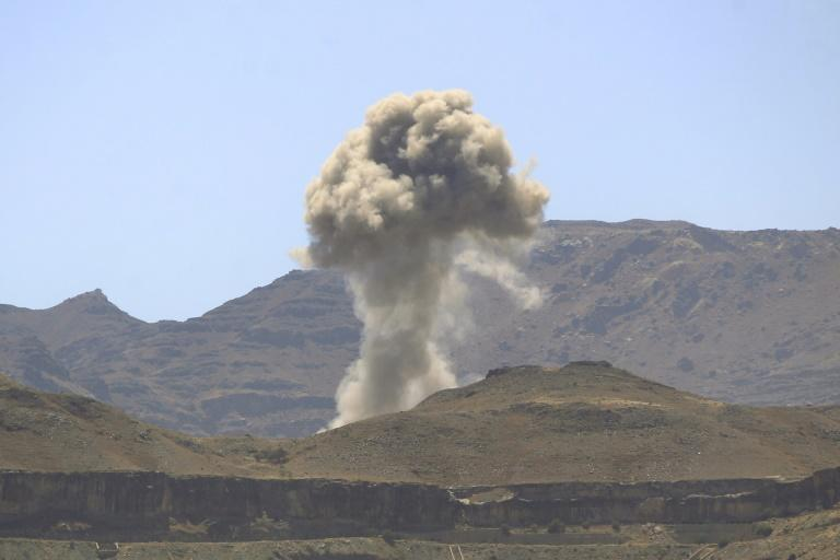 Smoke billows up following an air strike by the Saudi-led coalition in the Yemeni capital Sanaa targeting ballistic missile and drone depots on February 23, 2020