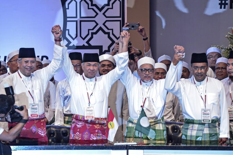 Umno president Datuk Seri Zahid Hamidi (second left) and PAS president Datuk Seri Hadi Awang (second right) at the Himpunan Penyatuan Ummah held at the Putra World Trade Centre in Kuala Lumpur September 14, 2019. — Picture by Shafwan Zaidon