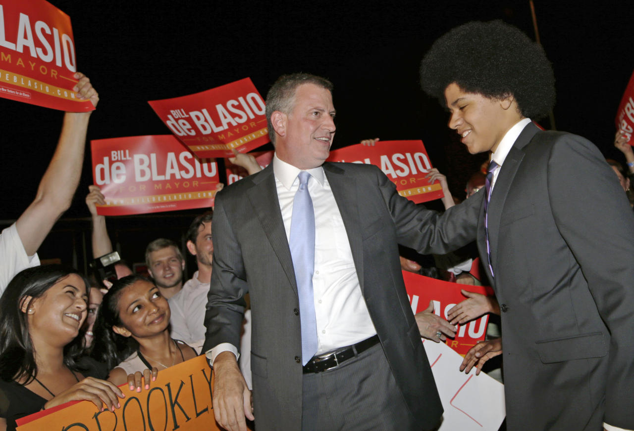 New York City Democratic Mayoral hopeful Bill De Blasio, center, arrives with his son, Dante De Blasio, right, at De Blasio's election headquarters after polls closed in the city's primary election Tuesday, Sept. 10, 2013, in New York. (AP Photo/Kathy Willens)