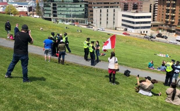 CBC News saw three people being arrested at a gathering on Citadel Hill over the weekend.