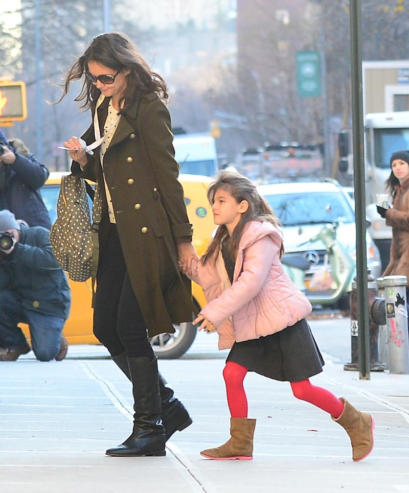Katie Holmes and Suri Cruise are seen walking Chelsea on December 11, 2013 in New York City. (Photo by Raymond Hall/FilmMagic)