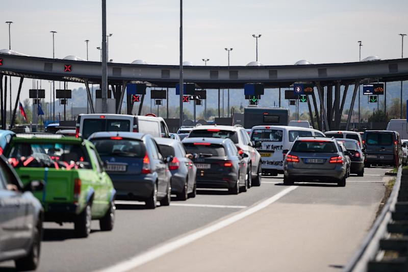 People wait in their cars to enter Croatia at the Obrezje border crossing point on the border between Slovenia and Croatia on April 7, 2017 in Obrezje, Slovenia
