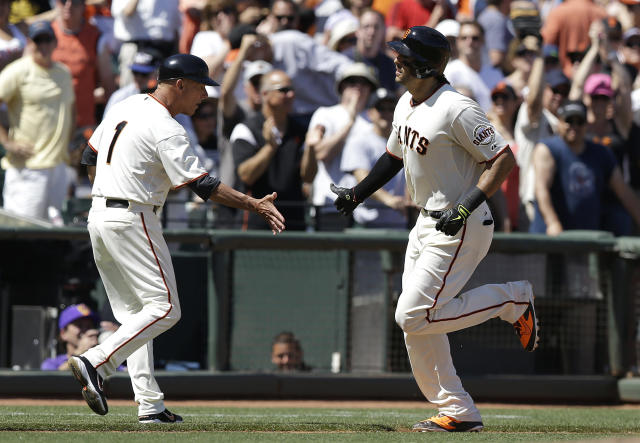 San Francisco Giants left fielder Michael Morse, right, is congratulated by third base coach Tim Flannery (1) after hitting a solo home run off of Atlanta Braves pitcher Alex Wood during the sixth inning of a baseball game in San Francisco, Wednesday, May 14, 2014. (AP Photo)