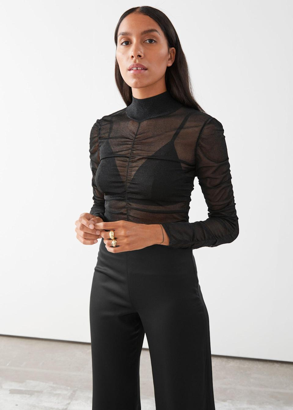 <p>I love the peekaboo fabric of this <span>Fitted Ruched Top</span> ($48, originally $69).</p>