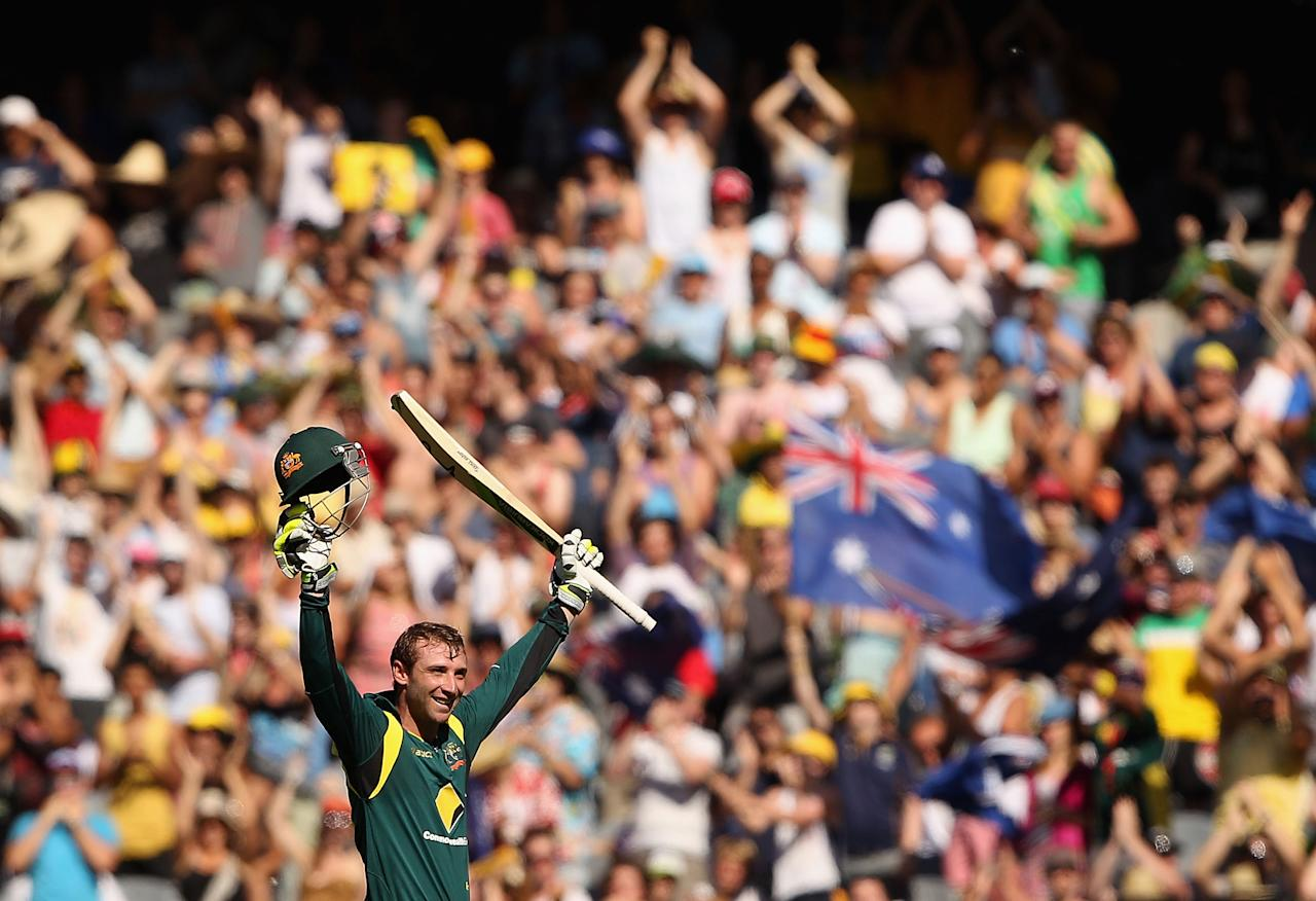 MELBOURNE, AUSTRALIA - JANUARY 11:  Phillip Hughes of Australia celebrates his century during game one of the Commonwealth Bank One Day International series between Australia and Sri Lanka at Melbourne Cricket Ground on January 11, 2013 in Melbourne, Australia.  (Photo by Robert Prezioso/Getty Images)
