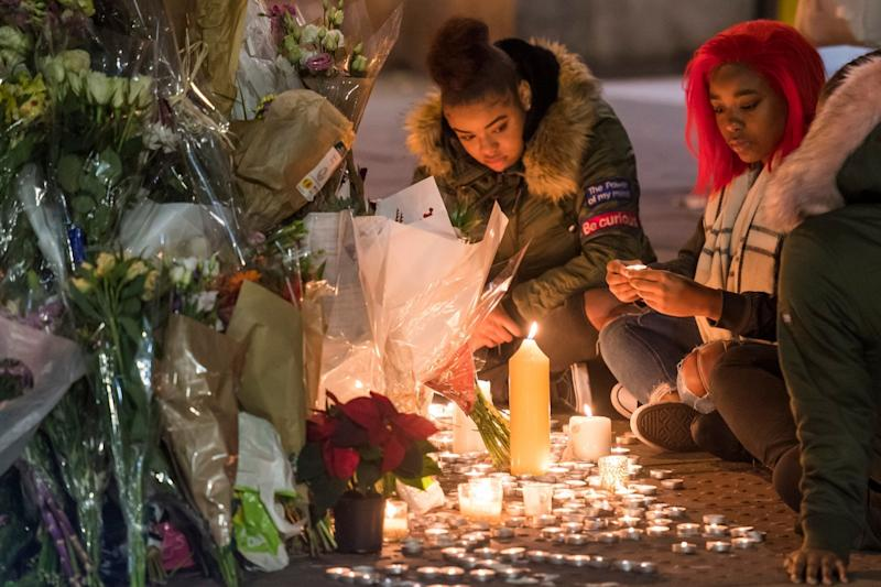 United in grief: a vigil is held for Malcolm Mide-Madariola, 17, the victim of the recent stabbing at Clapham South Tube station (Rex Features)