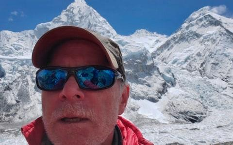 Christopher Kulish beneath Mount Everest - Credit: AP