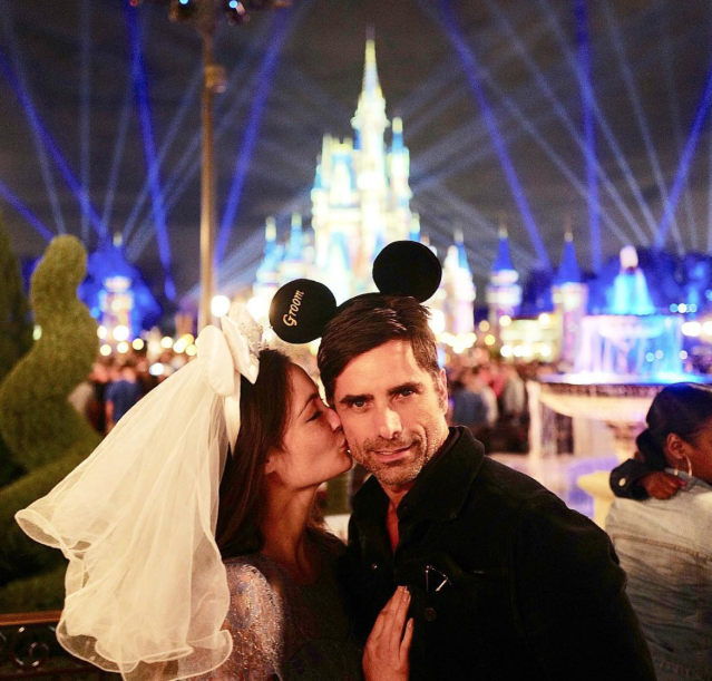 "<p>One week after they wed, Caitlin McHugh and John Stamos made a honeymoon trip to one of their favorite spots, Disney World, which he documented on social media. ""And they said it wouldn't last,"" Stamos joked in the caption. He hashtagged it, ""happiestmanonearth."" (Photo: <a href=""https://www.instagram.com/p/BfCOuZ1nB5I/?hl=en&taken-by=johnstamos"" rel=""nofollow noopener"" target=""_blank"" data-ylk=""slk:John Stamos via Instagram"" class=""link rapid-noclick-resp"">John Stamos via Instagram</a>) </p>"