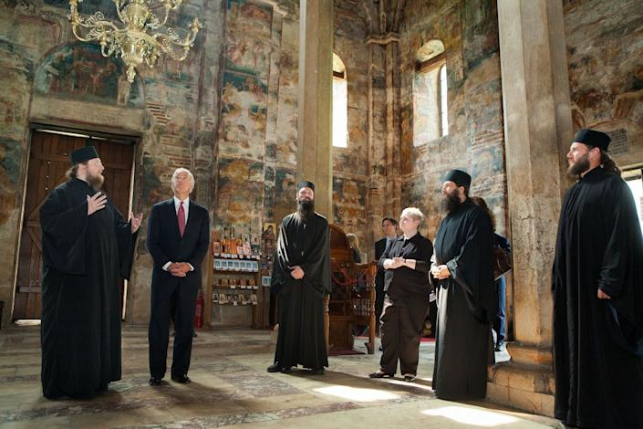 Biden tours the Decani Monastery with Serbian Orthodox Monk Father Sava, left, on May 21, 2009, in Decani, Kosovo.