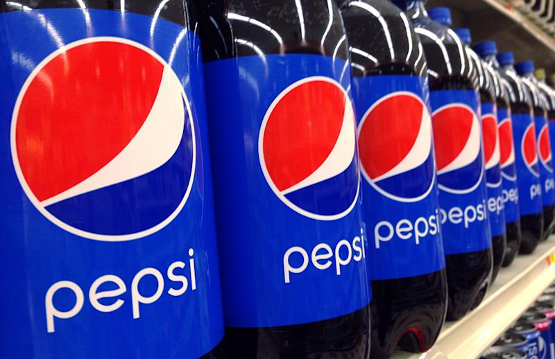 FILE - In this July 9, 2015, file photo, Pepsi bottles are on display at a supermarket in Haverhill, Mass. PepsiCo reports financial results on Monday, April 18, 2016. (AP Photo/Elise Amendola, File)