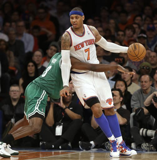 New York Knicks forward Carmelo Anthony (7) leans on defending Boston Celtics forward Jeff Green (8) as he controls the ball in the second half of Game 1 of a first-round NBA basketball playoff series, in New York on Saturday, April 20, 2013. The Knicks won 85-78. (AP Photo/Kathy Willens)