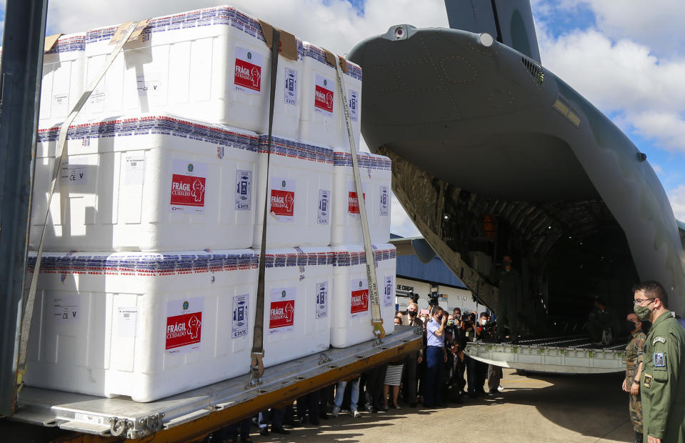 Brazilian soldiers load CoronaVac vaccines into a military plane at the Air Base of Sao Paulo in Guarulhos, Sao Paulo, Brazil, for their distribution across the country, on January 18, 2021, amid the novel coronavirus, COVID-19, pandemic. - The global Covid-19 vaccination drive gained pace Sunday as Brazil gave its first injections. Brazil's health regulator gave the green light for the Oxford-AstraZeneca vaccine and China's CoronaVac to be used as the Latin American giant suffers a devastating second wave of the coronavirus. (Photo by Miguel SCHINCARIOL / AFP) (Photo by MIGUEL SCHINCARIOL/AFP via Getty Images)