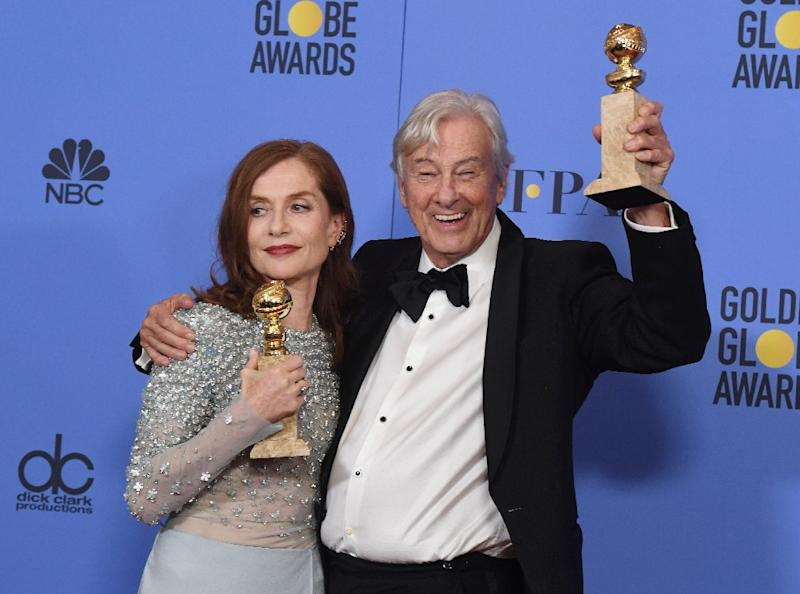 BEVERLY HILLS, CA - JANUARY 08: Actress Isabelle Huppert (L), winner of Best Actress in a Motion Picture - Drama for 'Elle,' and director Paul Verhoeven, winner of Best Foreign Language Film for 'Elle,' pose in the press room during the 74th Annual Golden Globe Awards at The Beverly Hilton Hotel