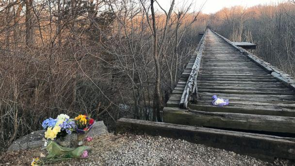 PHOTO: Flowers sit by a bridge near Delphi, Ind. where Liberty German and Abigail Williams were seen before they were reported missing by their families on Feb. 13, 2017. (Alex Perez/ABC News, FILE)