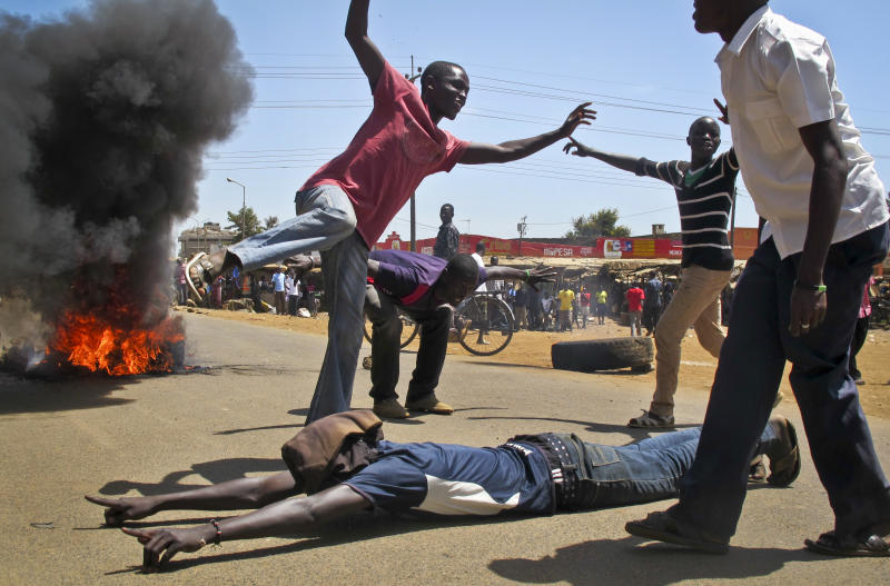 Protesters block a road with burning tires as they take to the streets to protest the results of the Orange Democratic Movement (ODM) primary elections, after they claimed that Ruth Odinga the younger sister of Kenyan Prime Minister Raila Odinga, had been declared the winning ODM candidate for the area's gubernatorial seat, which could not be immediately verified, in the town of Kisumu in western Kenya, Sunday, Jan. 20, 2013. Political parties in Kenya this week held their internal elections to decide candidates who will vie for gubernatorial, senate, county, and women representatives seats in the upcoming March 4 elections, a process which was fraught with irregularities, disorganization and disgruntled losers, increasing the chances of conflict during the upcoming vote, analysts said on Friday. (AP Photo)